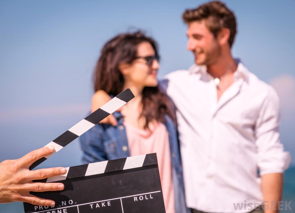 man-and-woman-with-a-hand-holding-a-film-slate