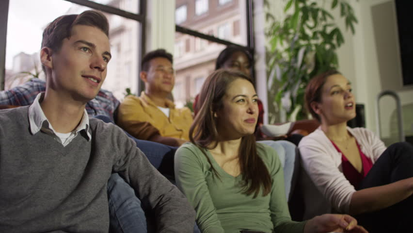 Group of four people watching TV - 3